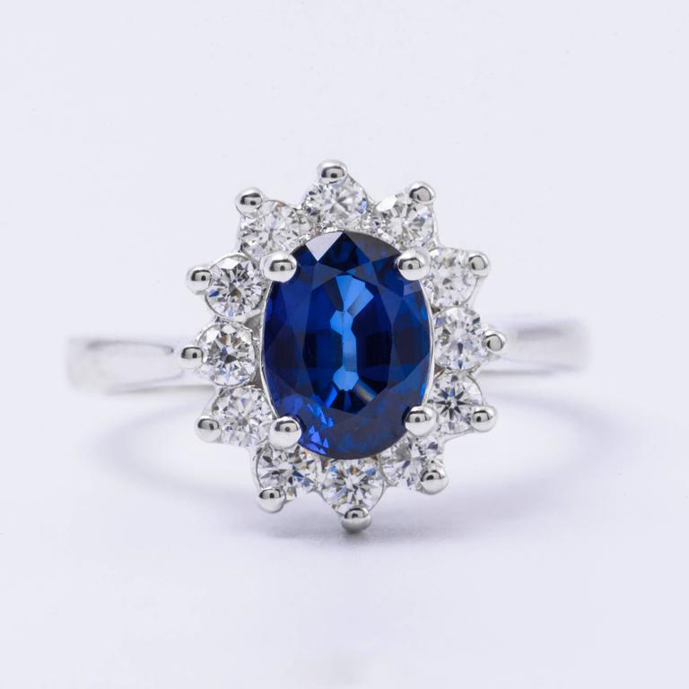 The oval sapphire in this ring has a total carat weight of 1.79 carats. The diamonds have a total carat weight of 0.47 carats. All our Gemstones are genuine, and are sourced with the highest degree of integrity.