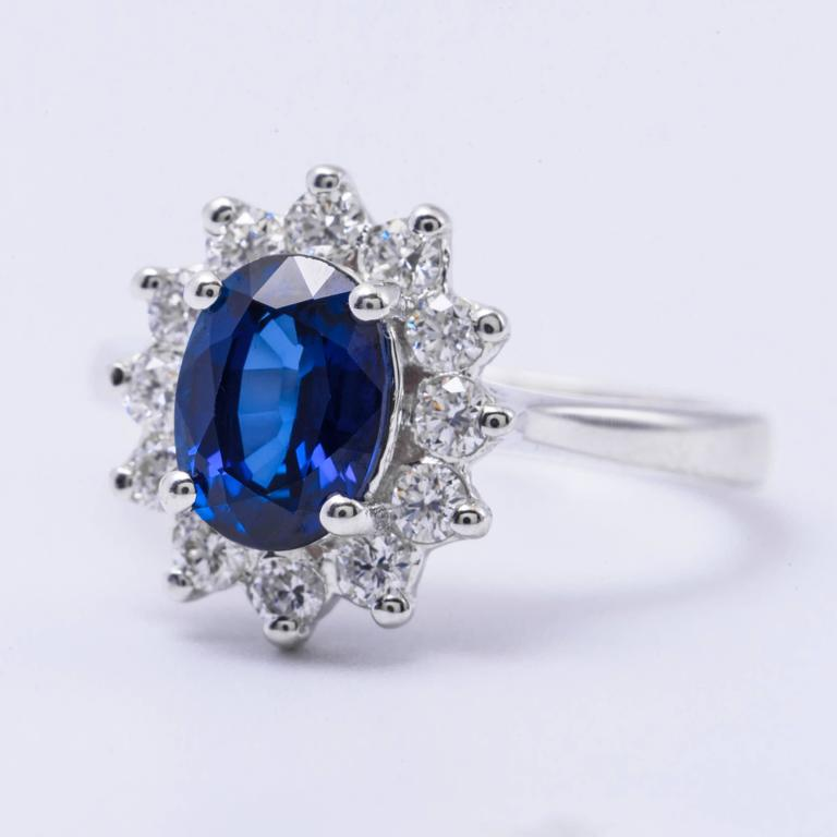 Contemporary Oval Sapphire and Diamond Engagement Ring 1.79 Carat For Sale