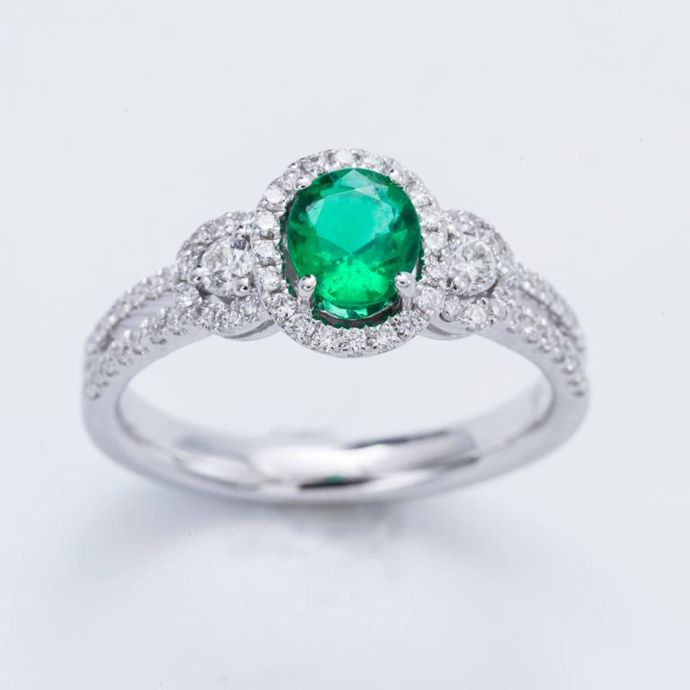 Contemporary Oval Shape Emerald Diamond Gold Halo Engagement Cocktail Ring For Sale