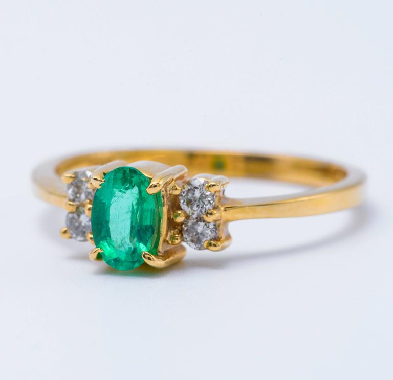 Oval Shaped Emerald and Diamond Engagement Ring in Yellow Gold 2