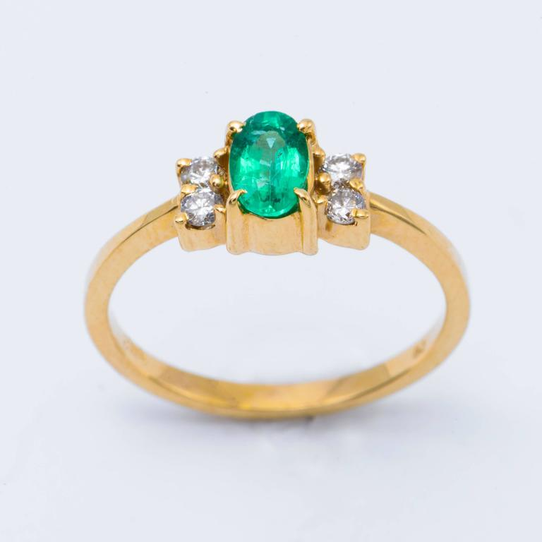 Oval Shaped Emerald and Diamond Engagement Ring in Yellow Gold 3
