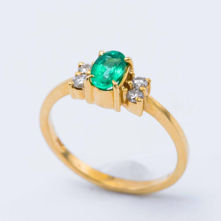 Oval Shaped Emerald and Diamond Engagement Ring in Yellow Gold 4