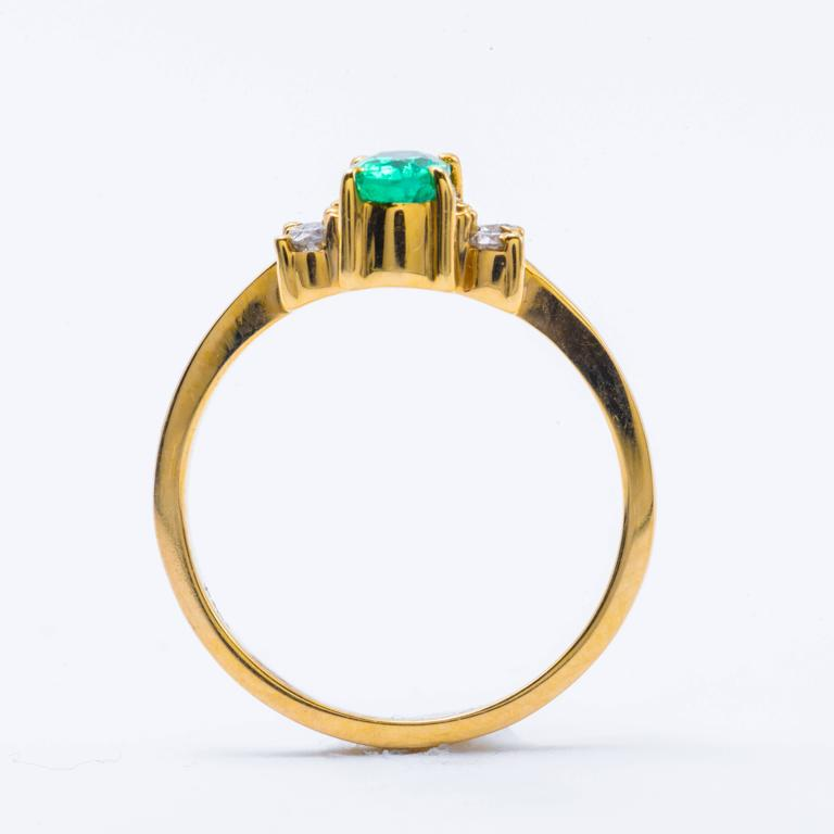 Oval Shaped Emerald and Diamond Engagement Ring in Yellow Gold 5