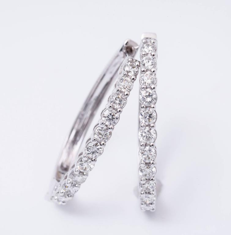 This beautiful Earring Is set in 14 K White Gold  with 1.00 cts T/W of diamonds in H Color and SI Clarity, The Earrings are 24.5 mm long.