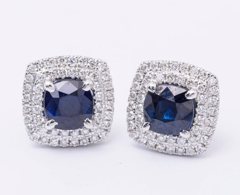 This stunning pair of sapphire earrings features: Sapphire:  2.29 Carats total weight 6 mm Diamonds: 0.55 Carats Diamonds 11 x 11 mm Earring Measurment