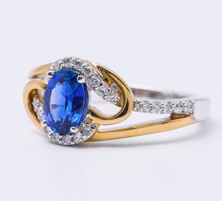This beautiful ring features: Ceylon Sapphire 0.97 Carats 7x5 mm 14K white/yellow gold Diamonds: 0.19 Carats