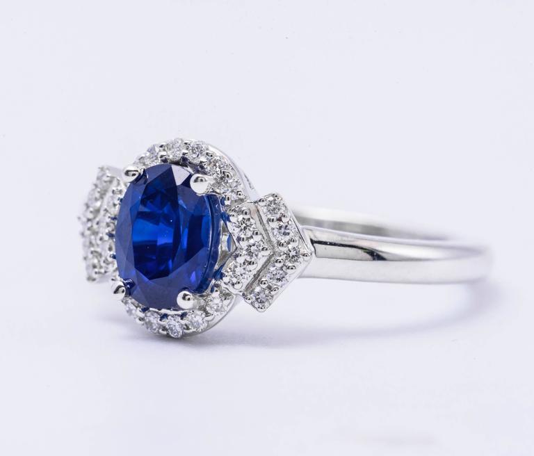 14K white gold Sapphire: 7mm x 5mm 0.94 Carats Diamonds:0.17Carats