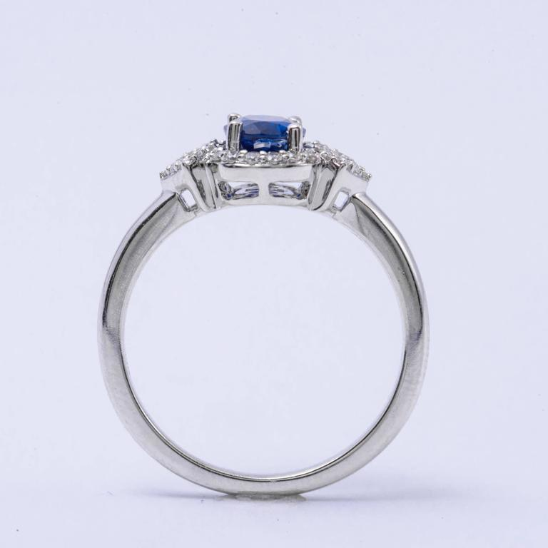 Contemporary Oval Shape Sapphire and Diamond Engagement Halo Ring For Sale