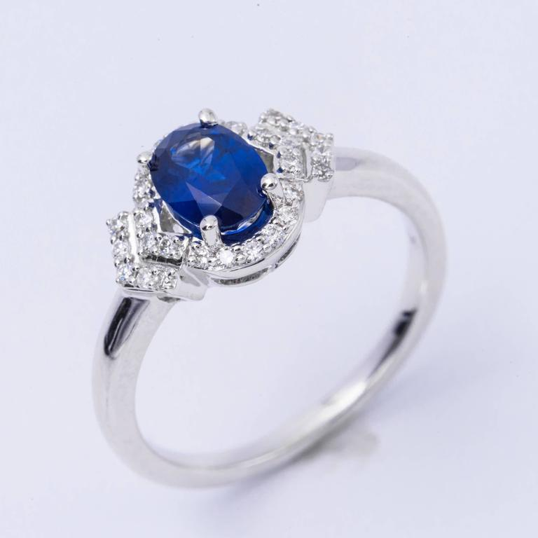 Women's Oval Shape Sapphire and Diamond Engagement Halo Ring For Sale