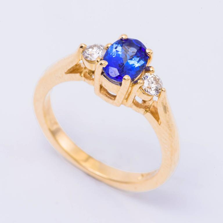 14K yellow gold with a 6X4 mm Tanzanite 0.77 Cts. Diamond Weight: 0.22 Cts.
