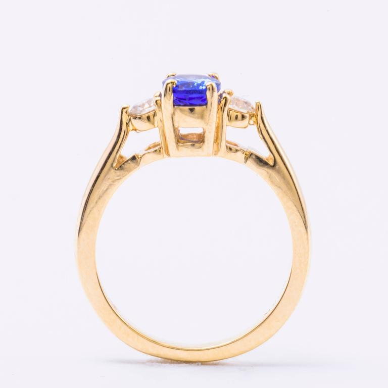 Contemporary Oval Tanzanite Diamond Gold Three-Stone Engagement Ring For Sale