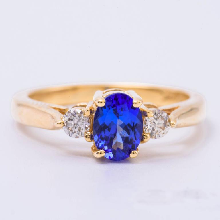 Oval Tanzanite Diamond Gold Three-Stone Engagement Ring In As new Condition For Sale In New York, NY