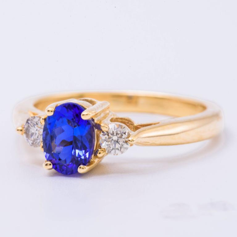 Women's Oval Tanzanite Diamond Gold Three-Stone Engagement Ring For Sale