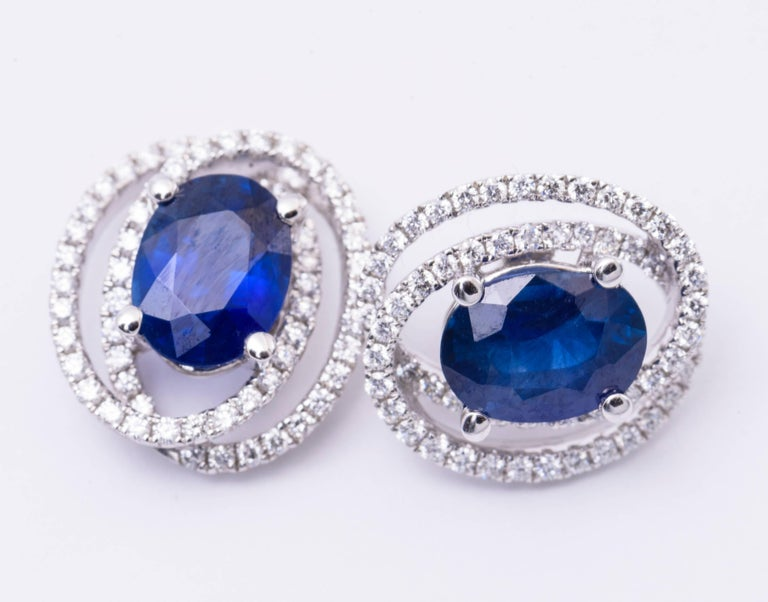 Sapphire measuring 8 x 6 mm for a total weight of 3.12 Cts Diamonds Weight: 0.53 Cts. Earrings measures: 14 x 12 mm