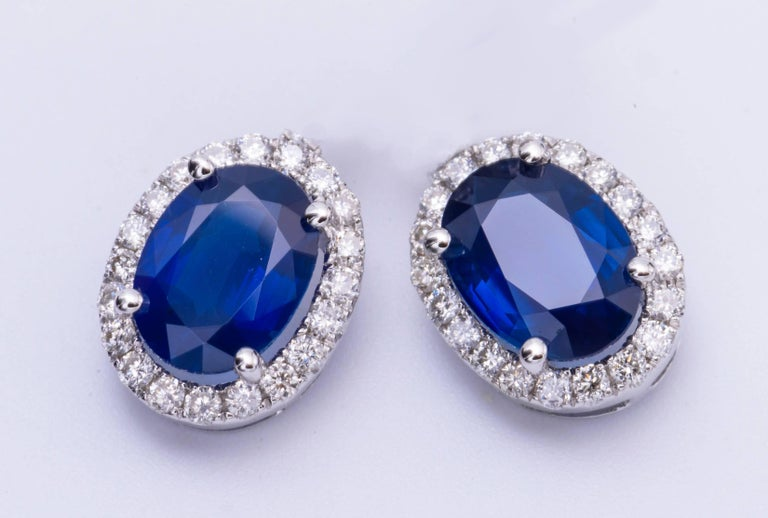 14K White gold 6 x 4 sapphire 1.24 Cts. Diamonds 0.17 Earrings measures 9 x 7 mm