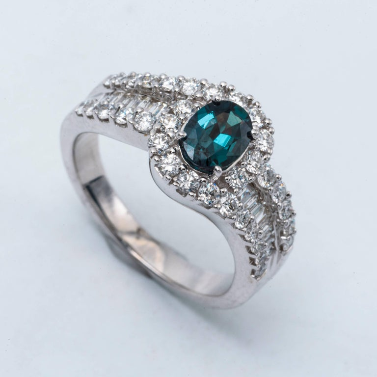 Contemporary Oval Shape Alexandrite and Diamond Ring with Certificate 0.75 Carat For Sale