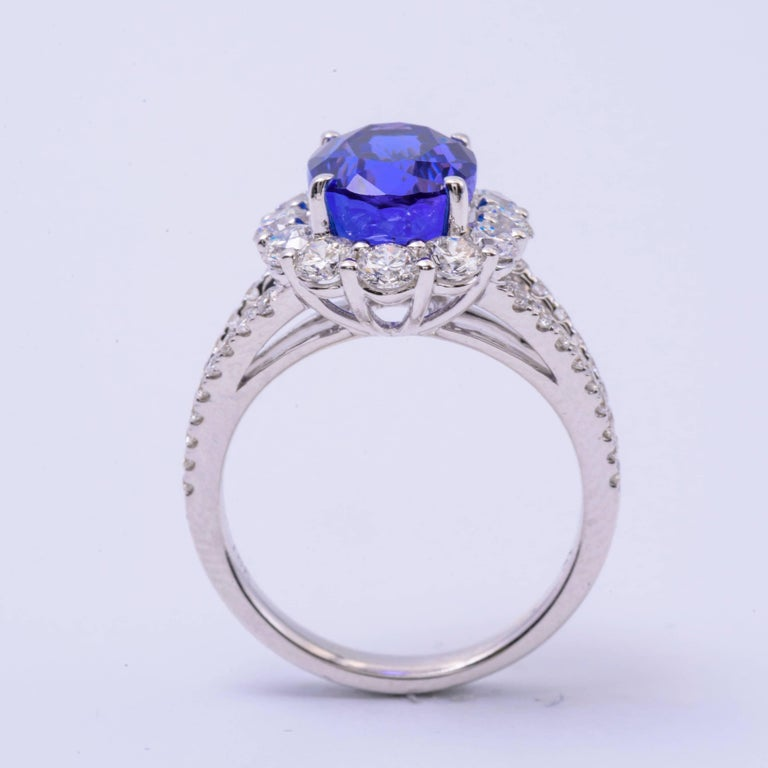 Oval Tanzanite and Diamonds Halo Cocktail Engagement Ring 4.85 Carat In As new Condition For Sale In New York, NY