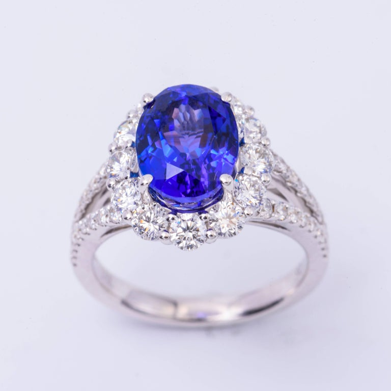 Women's Oval Tanzanite and Diamonds Halo Cocktail Engagement Ring 4.85 Carat For Sale