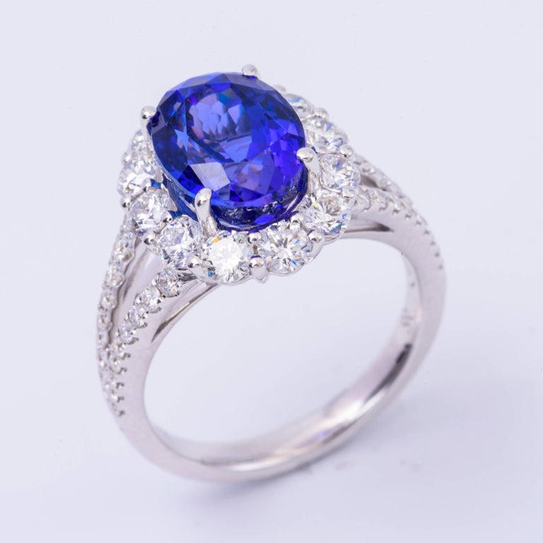Beautiful crafted in 18K White gold this ring features a 10x 8 mm Tanzanite for a total weight of 4.85 Carats  The diamonds surrounding this beautiful stone has a total weight of 1.53 Carats. All our gemstones are genuine, and are sourced with the