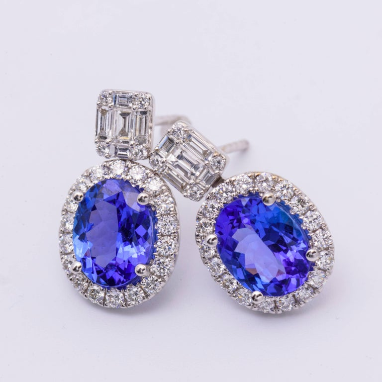 Contemporary 18 Karat Tanzanite Drop Earrings with Round and Baguette Diamonds 3.30 Carat For Sale