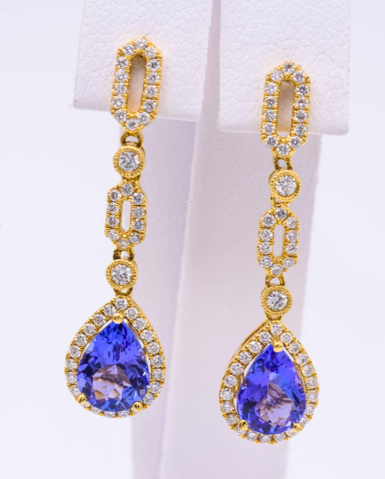 Pear Shape Tanzanite measuring each 8 x 6 mm for a total weight of 2.10 Cts. Diamond Weight: 0.47 Cts. Earring measuring 32 x 9 mm