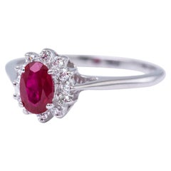Oval Ruby and Diamonds Halo Ring