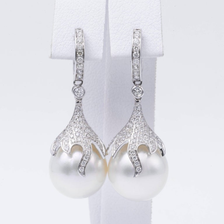 Stone Count 1122 Pearl Size12-13mm NatureSouth Sea Cultured Pearl Pearl QualityAAA LusterAAA, Excellent NacreVery Thick Jewelry StyleEarrings Metal Purity18K Metal TypeWhite Gold Stone Shape Round Stone Weight 10.73 ct. Stone Color G+