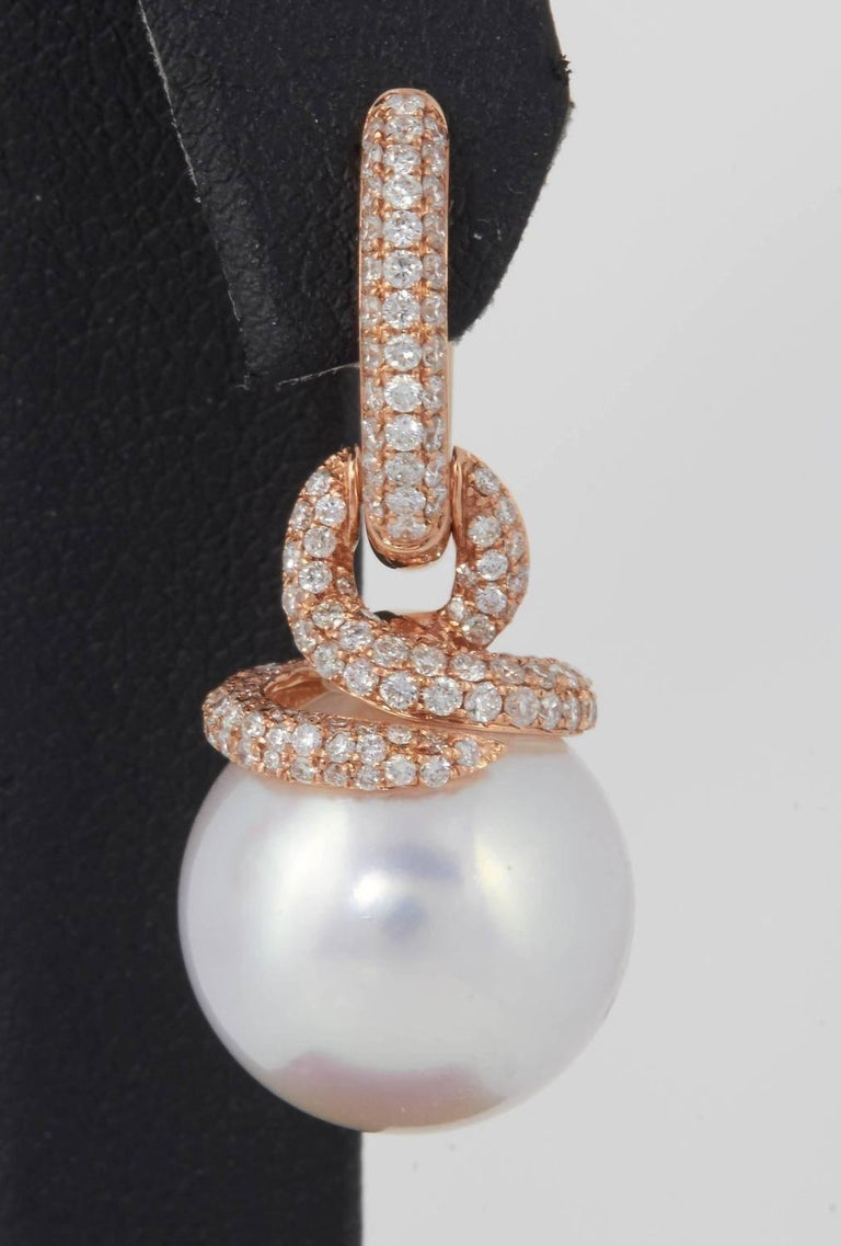 Gold ; 18k Rose Gold Pearl: South Sea Pearl Pearl Size; 14-15 mm Pearl Quality: AA Diamond Weight; 1.55 Cts. Gold Weight: 5.5 g