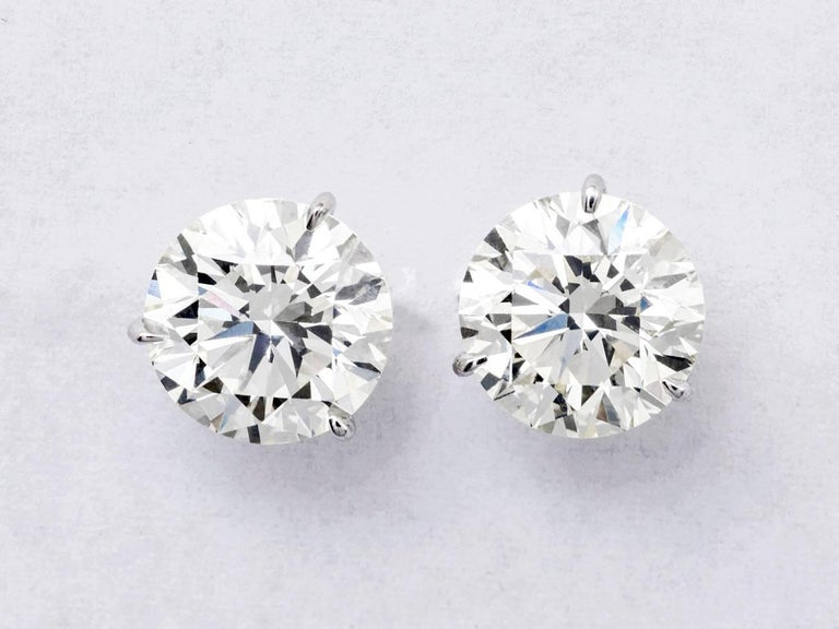 This Studs Features: 4.24 T/W Metal: 18k Gold: White Gold Color: g-h Clarity: I1 3 Prong, Champagne Setting  AGI Appraisal This stud are  guaranteed to be eye clean