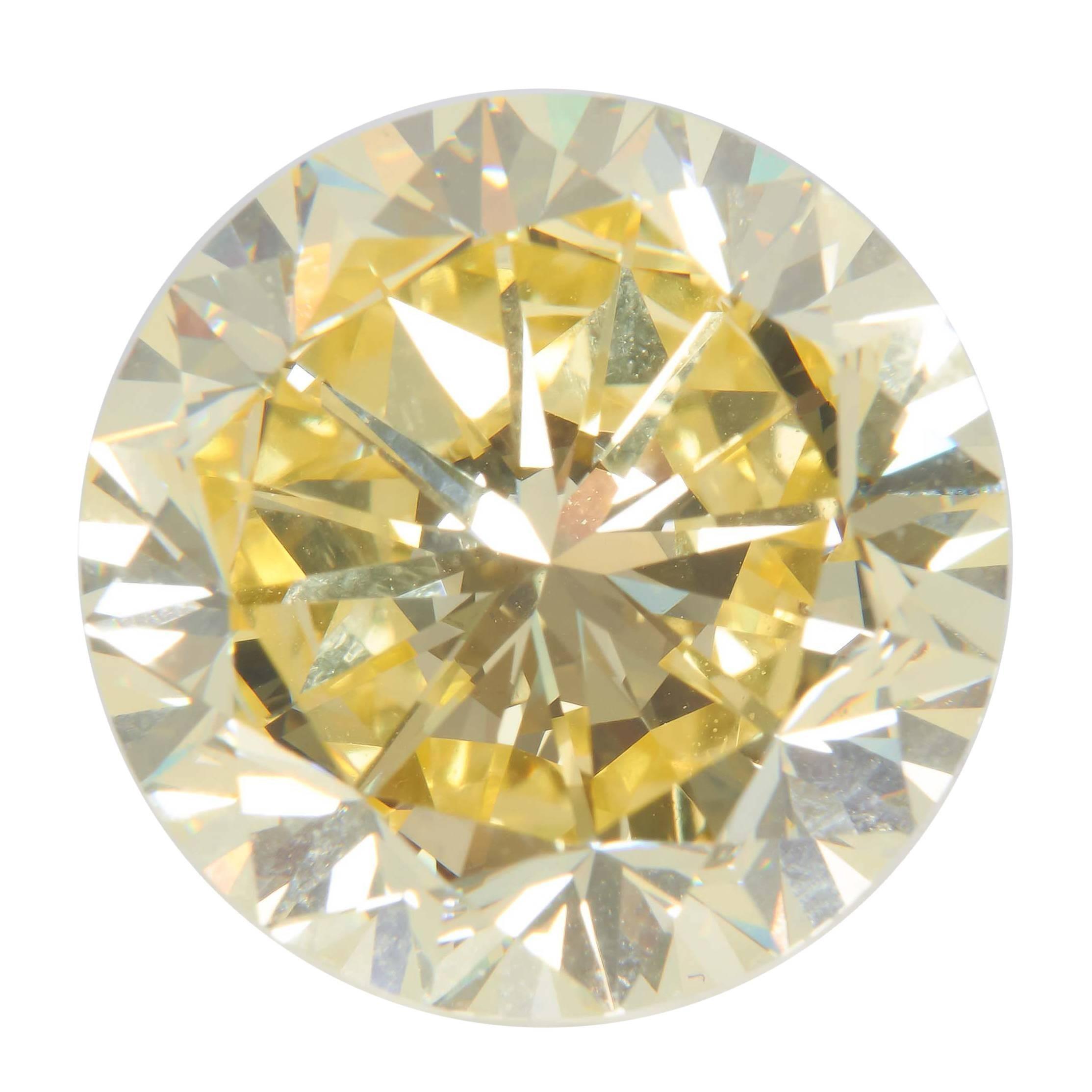 Natural Fancy Intense Yellow Diamond 22.77 Carat Platinum Ring