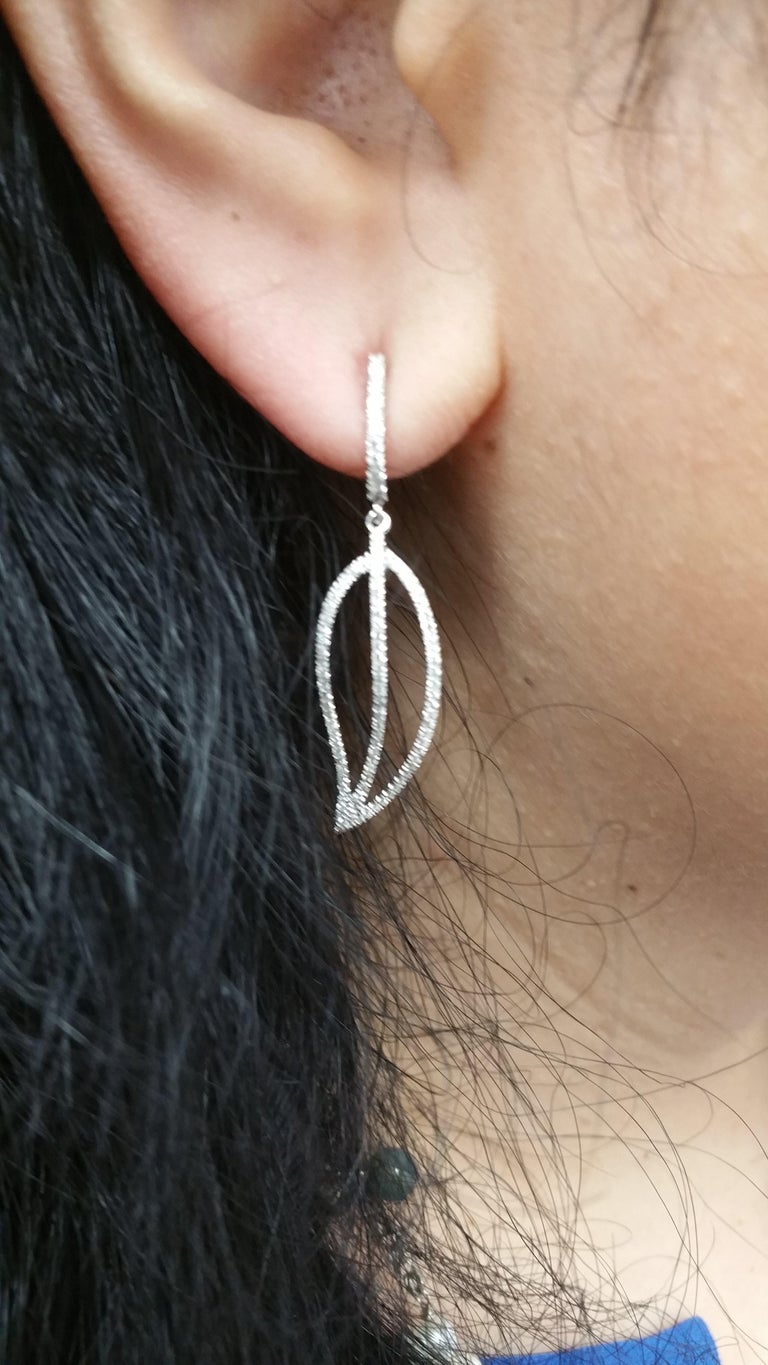 Beautiful Earrings featuring: 18k white gold 0.60 total cts. weights metal weights: 3.6 grams diamond shape: rounds diamond counts: 188 diamond clarity : SI1 diamond color: G+ the earrings are 0.5