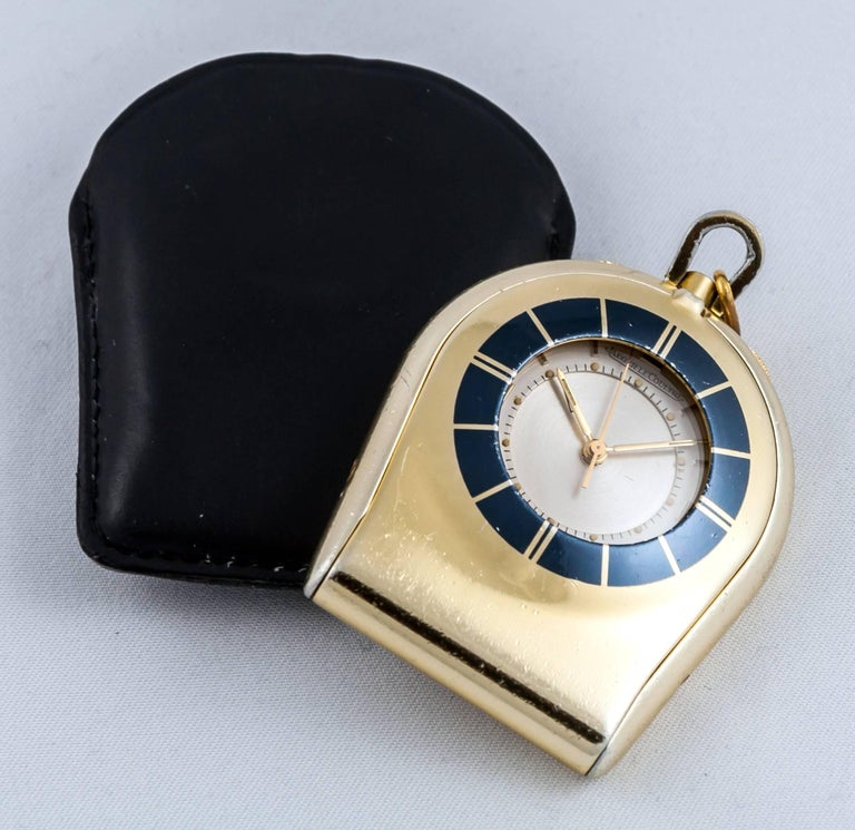 "JAEGER LECOULTRE Pocket watch ""Memovox"" travel. Mother-of-pearl dial. Gold needles and indexes. Mechanical movement. Alarm. Leather pouch. Warranty 1 year."