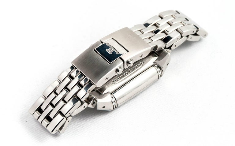 JAEGER LECOULTRE Watch Reverso Lady Duoface. Steel / Steel bracelet. One face bezel diamonds dial silver. Moon phase. One silvered dial face. Power reserve. Seconds at 6H. Mechanical movement. Warranty 1 year.