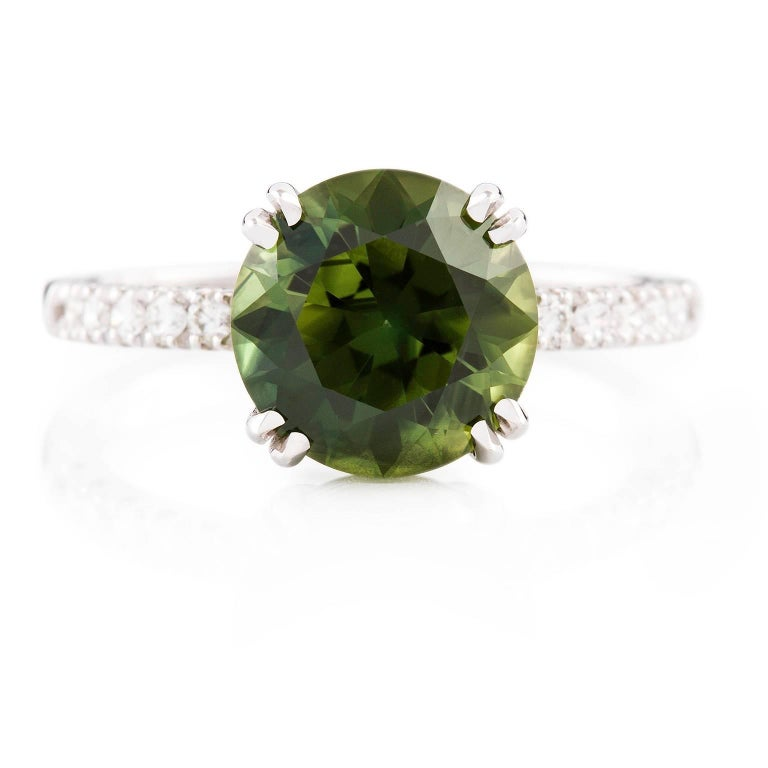 18 carat white gold green sapphire and ring