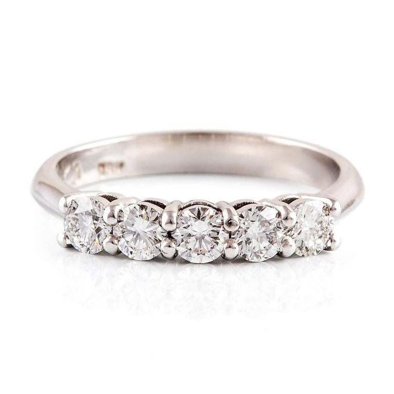 Bianca Eternity Ring  Simple, timeless, stunning. This 18ct white gold eternity ring is set with five lovely diamonds. This design also makes the perfect dress or other special commitment ring.  Round brilliant cut diamonds: F colour, VS clarity,
