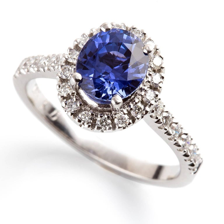 Blu Zaffiro Halo Ring  Set with the finest blue Ceylon sapphire and surround by a halo of diamonds and diamonds extending into the band, this ring is absolutely beautiful.  Oval faceted sapphire: finest medium blue colour, natural, untreated,