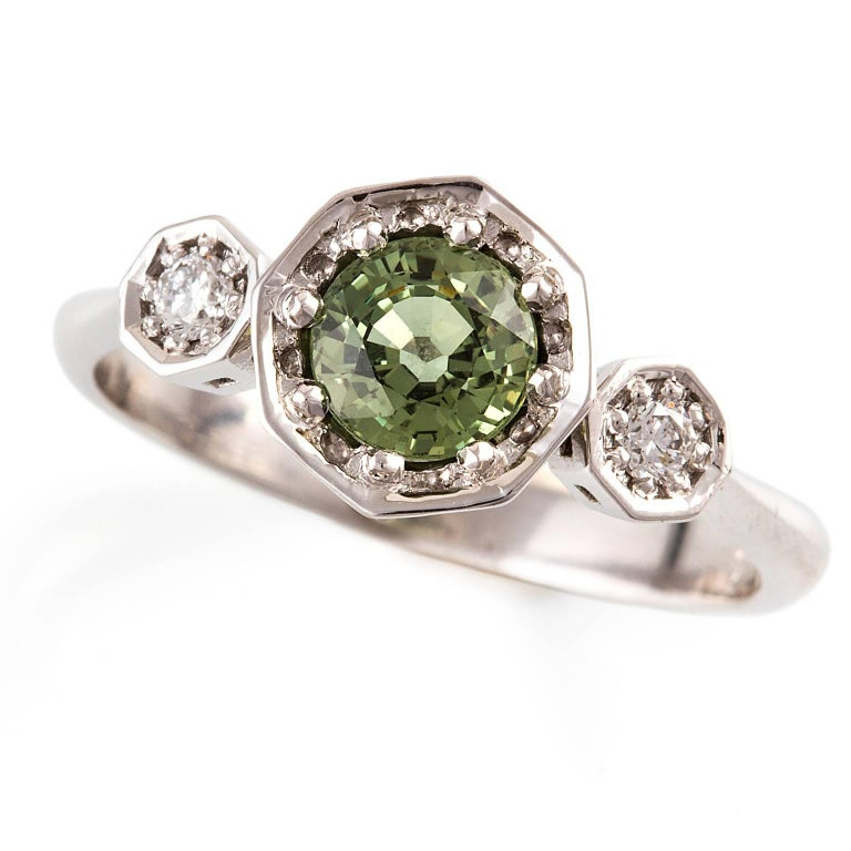 18 carat white gold green sapphire and deco