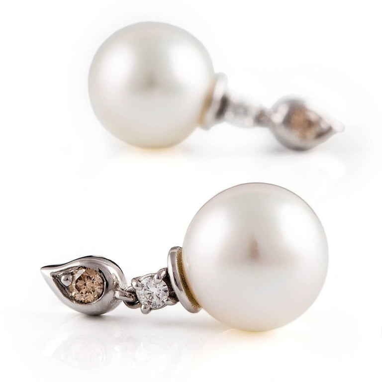 Tear Drop Perla Earrings  These exquisite earrings are set with a stunning pair of South Sea pearls, a white diamond pair and a cognac diamond pair that are contained within the fancy tear drop motifs.   South Sea pearls: white color, high luster,