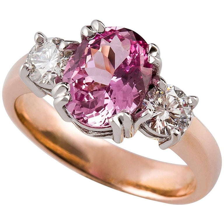 Rosa Zaffiro Ring  This gorgeous heirloom style 18ct rose gold ring is set with a stunning pink sapphire and pair of white diamonds in 18ct white gold settings.  Oval cut sapphire: intense medium pink colour, 9.05 x 7.08 x 4.29mm, 2.23ct, please