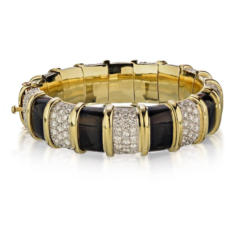 Tiffany & Co. Schlumberger Black Enamel and Diamond Bangle Bracelet in Platinum, 18K Yellow Gold with 207 Diamonds Apron. 22 Ct. With Tiffany fitted box)