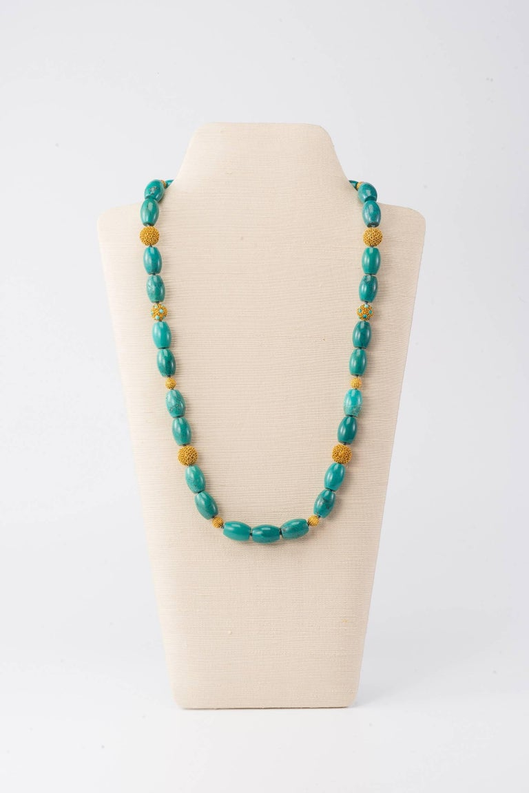 28.5 in L (72cm L) necklace with Tibetan turquoise, vermeil beads &18K gold clasp, in Chinoiserie design  Beautifully coloured turquoise barrel-form beads are offset by the delicate filigree work on the hand-worked vermeil beads.