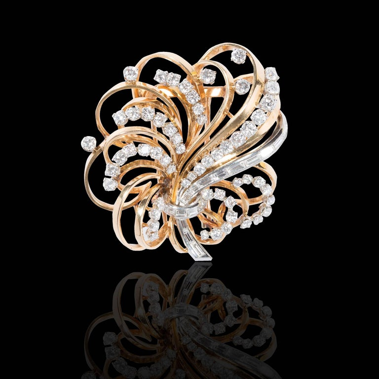 -Boucheron 1940's ,18 carat gold , platinum and diamonds' brooch-pendant forming a wreath set with brillant-cut diamonds in gradient and a rank of a pin baguette cut diamonds . -57 brillant-cut diamonds . -18 pin baguette diamonds. -BOUCHERON is a