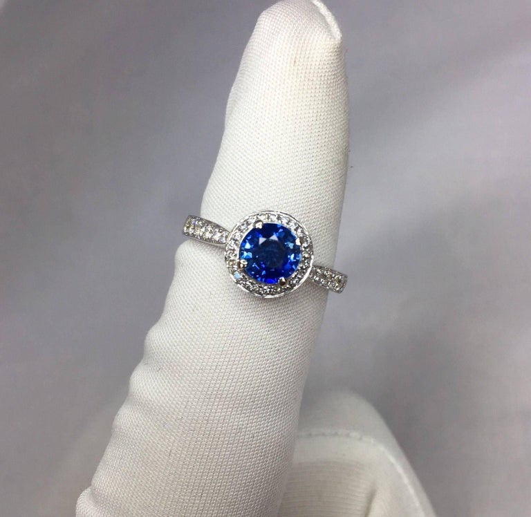 1.30 Carat Ceylon Blue Sapphire and Diamond Halo Ring 18 Karat White Gold 3