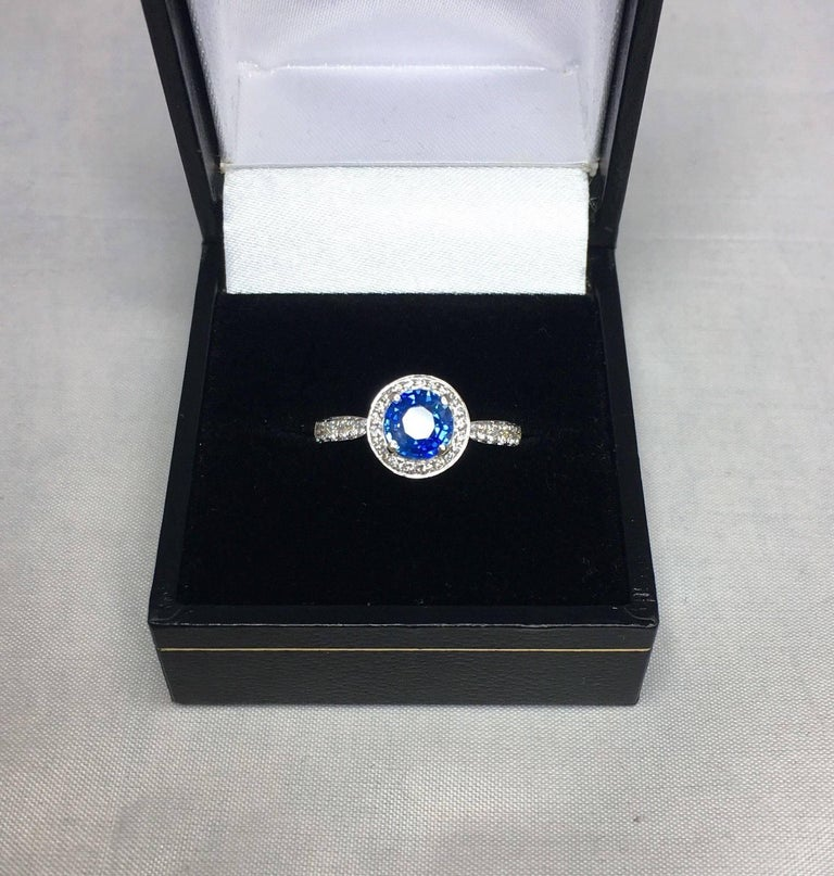 1.30 Carat Ceylon Blue Sapphire and Diamond Halo Ring 18 Karat White Gold 6