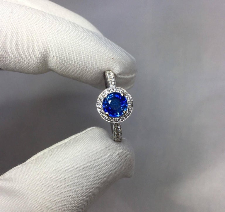 1.30 Carat Ceylon Blue Sapphire and Diamond Halo Ring 18 Karat White Gold 4