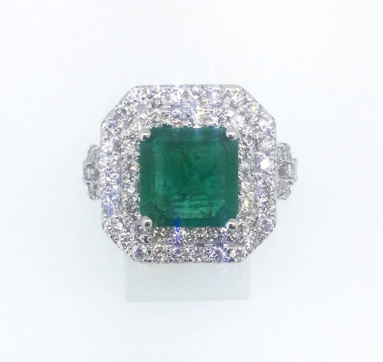 This 18K White Gold Ring has a Square Cut Emerald that weighs a total of 4.48 carats. It has 78 Round Brilliant Cut Diamonds weighing at 1.80 carats. The gold gram is 10.8gr.  This ring is a ring size of 7 and can be re-sized at no additional