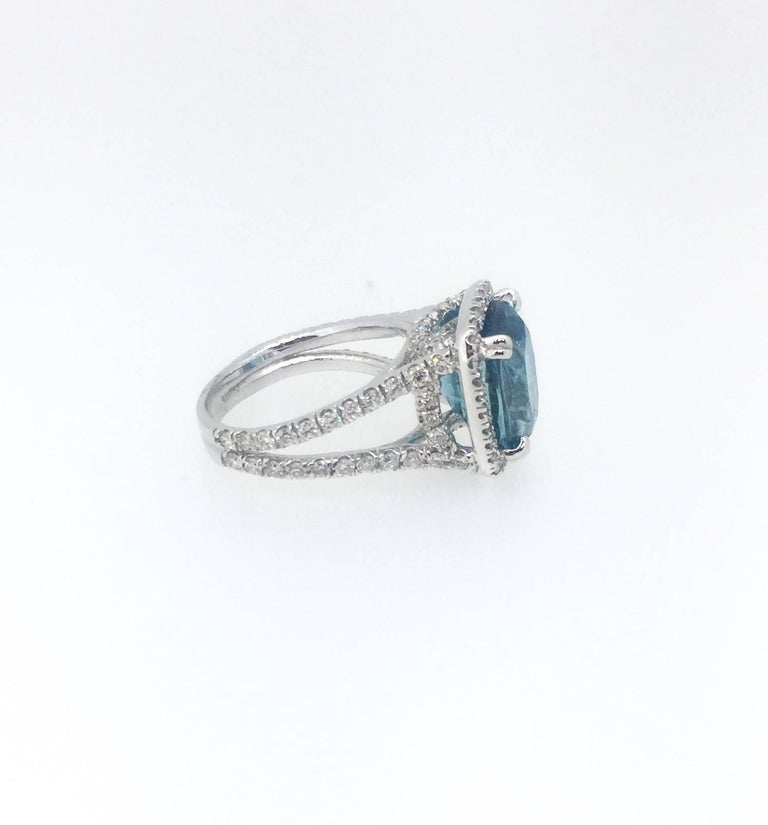 blue zircon and ring in 18 karat white gold for