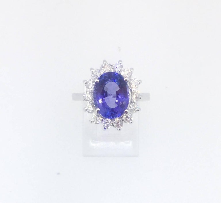 A gorgeous 3.91 Carat Tanzanite and Diamond Ring!   The Tanzanite is an Oval cut stone and weighs 3.28 carats.  The ring is surrounded by 14 Round Brilliant Cut diamonds that weigh 0.63 carats. (Clarity: SI1 and Color: F)  The total carat weight of