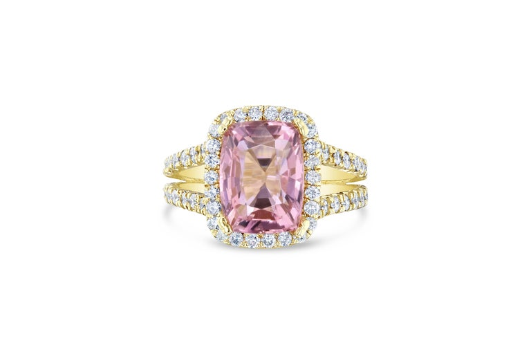 Beautifully crafted Pink Tourmaline and Diamond Ring! This ring has a 4.46 carat Rectangle Cut Tourmaline in the center of the ring and is surrounded by 94 Round Cut Diamonds that weigh 1.41 carats. The clarity and color is VS2/H.  The total carat