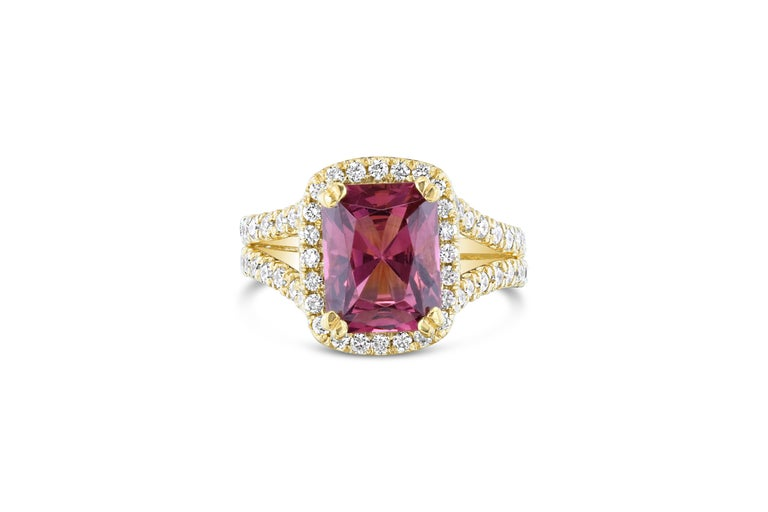 Stunning Dark Pink Tourmaline and Diamonds set in a spit-shank and halo setting! This ring has a 2.97 carat Rectangle Cut Tourmaline in the center of the ring and is surrounded by 92 Round Cut Diamonds that weigh 1.04 carats. The clarity and color